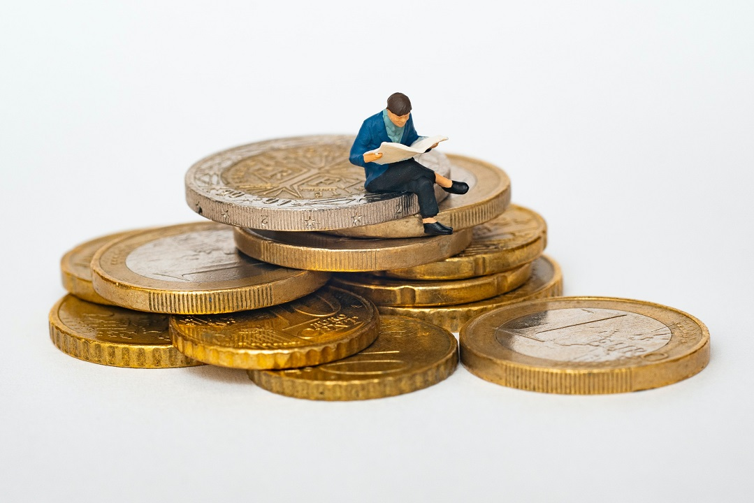 Capital International, a toy mini person over coins