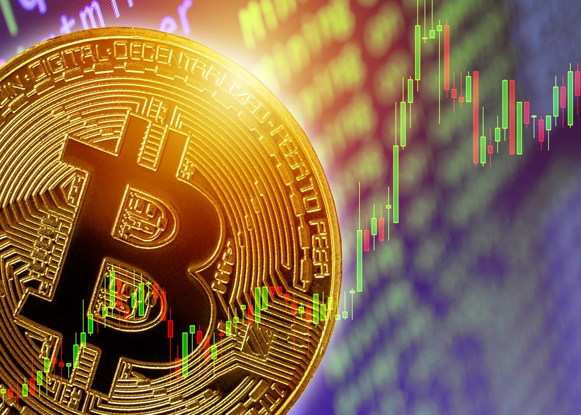 picture of a bitcoin with upwards candlestick chart behind it