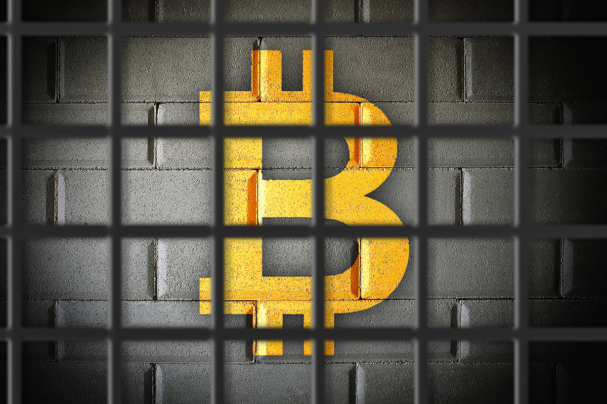 picture of a bitcoin locked behind prison bars